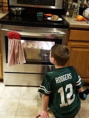 Benson Foust watching cookies bake