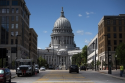 Buildings flank the Wisconsin State Capitol