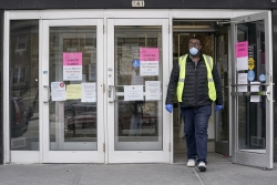 A worker leaves the Frank P. Zeidler Municipal Building in Milwaukee