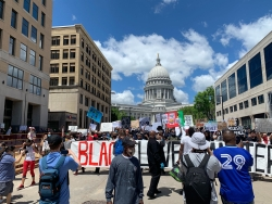 Demonstrators march in Madison