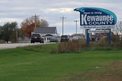"""A sign reads """"Thanks for visiting Kewaunee County."""""""