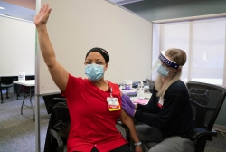 UW Health respiratory therapist Tina Schubert is the first of UW Health's health care worker to receive the coronavirus vaccine