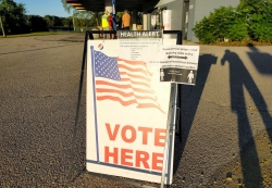 """A sign at a polling place on the northside of Madison also contains information about social distancing and a """"health alert"""""""