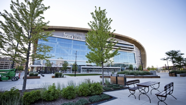 an empty table at a restaurant is located near the Fiserv Forum in Milwaukee