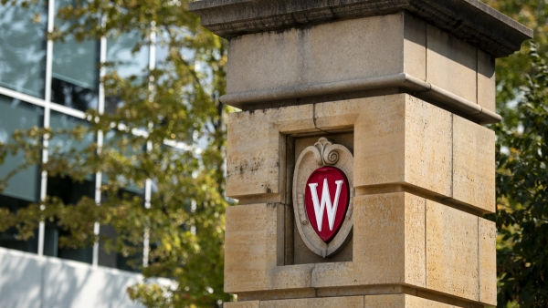 "A red ""W"" logo is seen on a column on UW-Madison's campus"