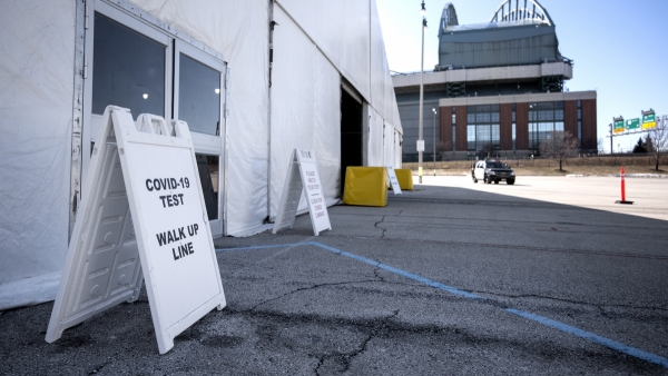 """A sign says """"COVID-19 Test Walk Up Line"""""""