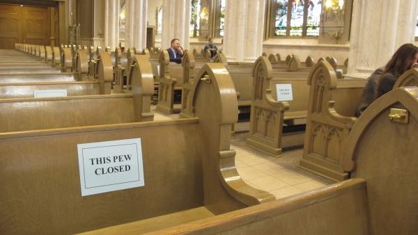 Half of the pews were closed to congregants as services resumed at the Cathedral of St. Helena