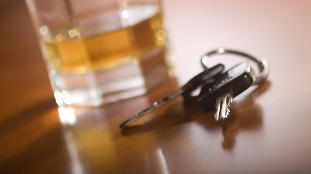 keys by a glass of alcohol