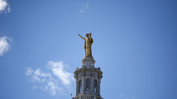 The statue on top of the Wisconsin State Capitol