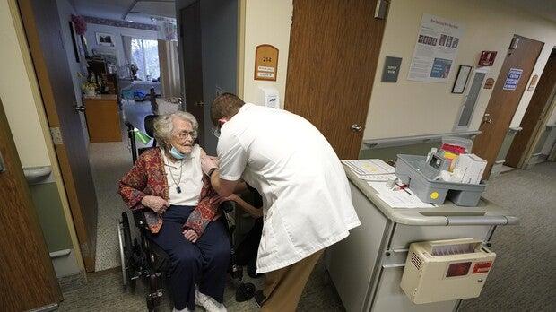 Jean Allen, 96, receives a COVID-19 vaccination