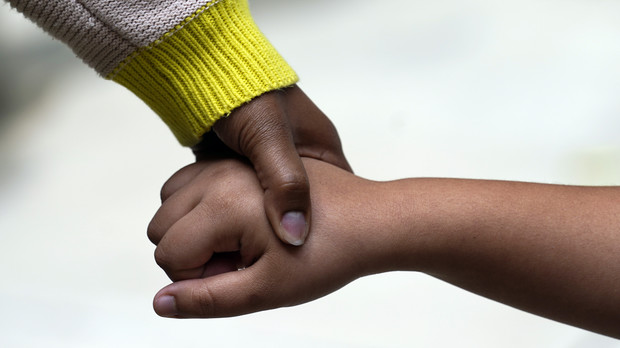 Danielle Williams, holds the hand of her 14-year-old daughter Anastasia Mechekoff