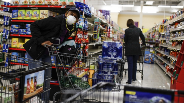 Customers shop at the grocery store during the coronavirus pandemic