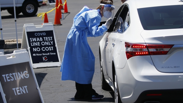 Dr. Sabrina Solt conducts an appointment-only drive-thru COVID-19 swab test