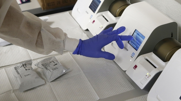A CVS pharmacy technician, shows how COVID-19 tests are processed