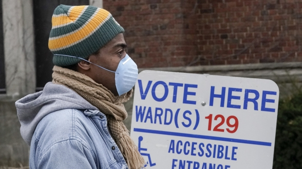 Voters in masks line up for Wisconsin's April primary election