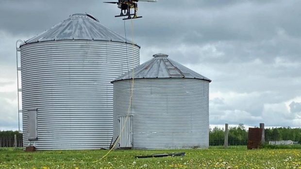 """Wisconsin Telelift drones are """"tethered"""" by a wire to a power source on the ground."""