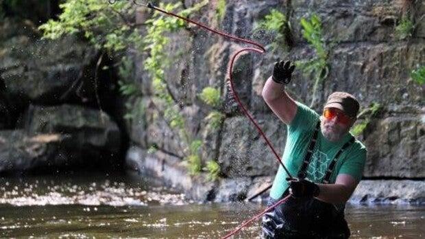 Man magnet-fishing in water