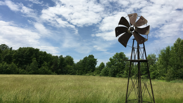 Old windmill in farm field