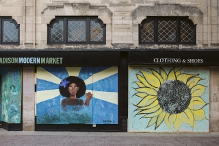 Artwork by Sapphina and Zaria isdisplayed on boarded up store windows on State Street