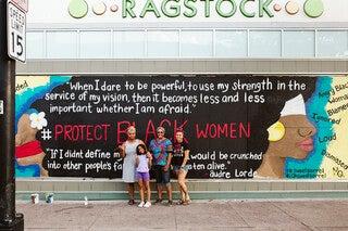 Maia Pearson,Cassandra Marzette andChaNelle Baines work on a collaborative muralon Ragstock