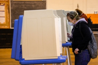 Voter casting ballot at Riverside High School in Milwaukee