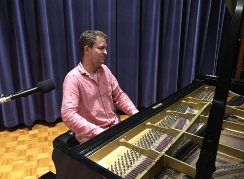 Photo of Pianist Andrew Armstrong in the WPR studios