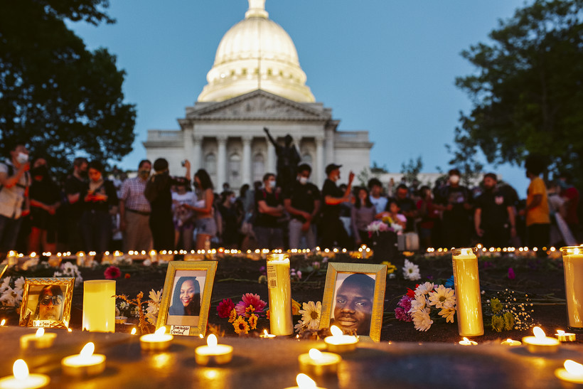 Photos and candles honor black people killed by police