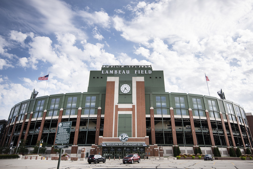 Clouds and a blue sky can be seen behind Lambeau Field