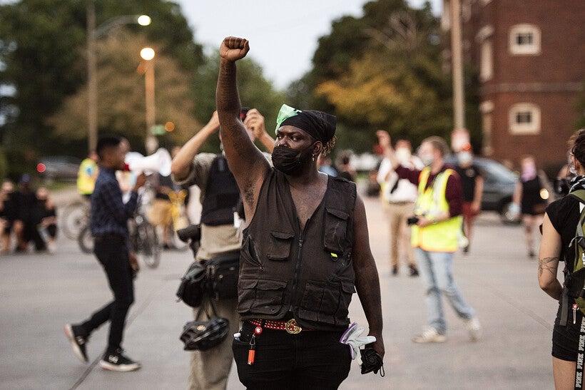 a protester raises his fist