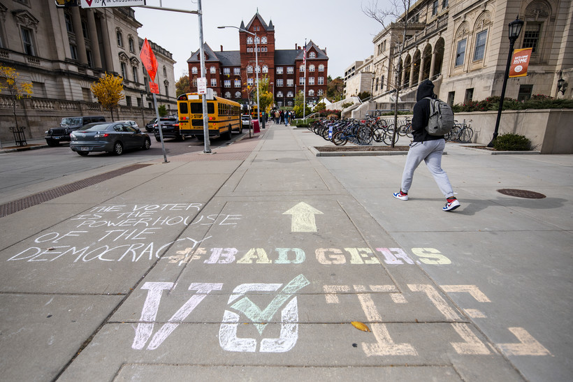 """Chalk on the ground reads """"Badgers VOTE"""""""