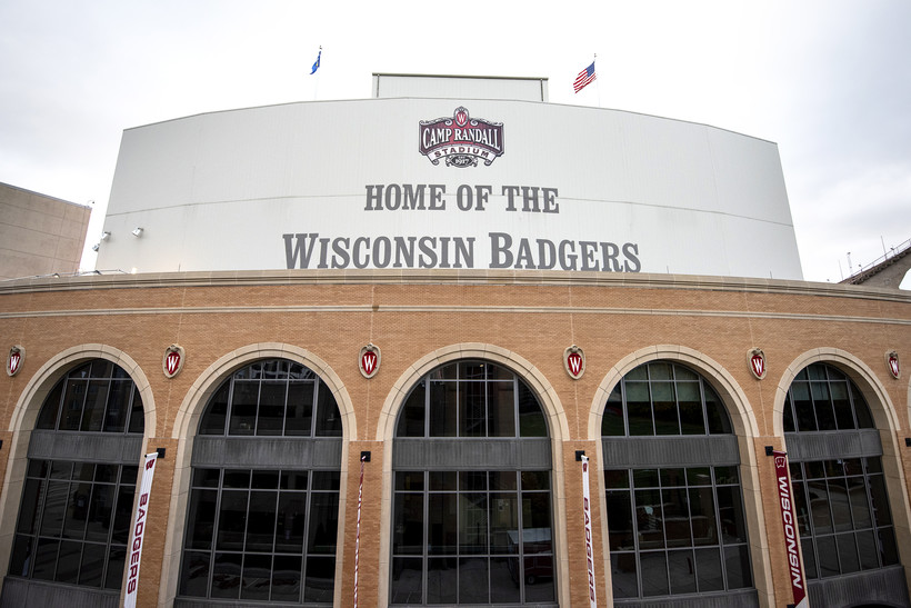 """""""Home of the Wisconsin Badgers"""" is written on the side of the stadium"""
