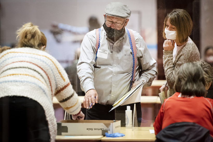A man points with a pen as the recount goes on