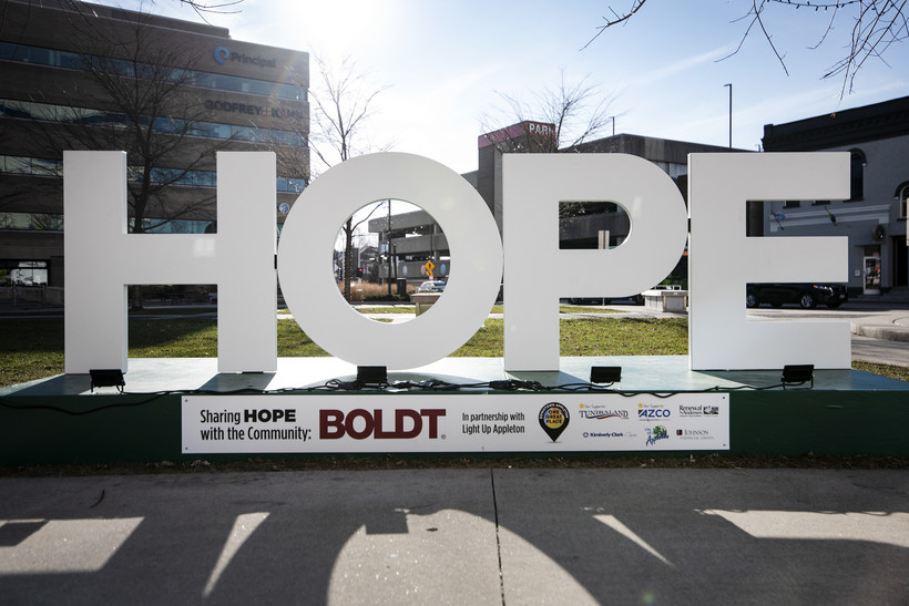 "large white letters spell out the word ""HOPE"""