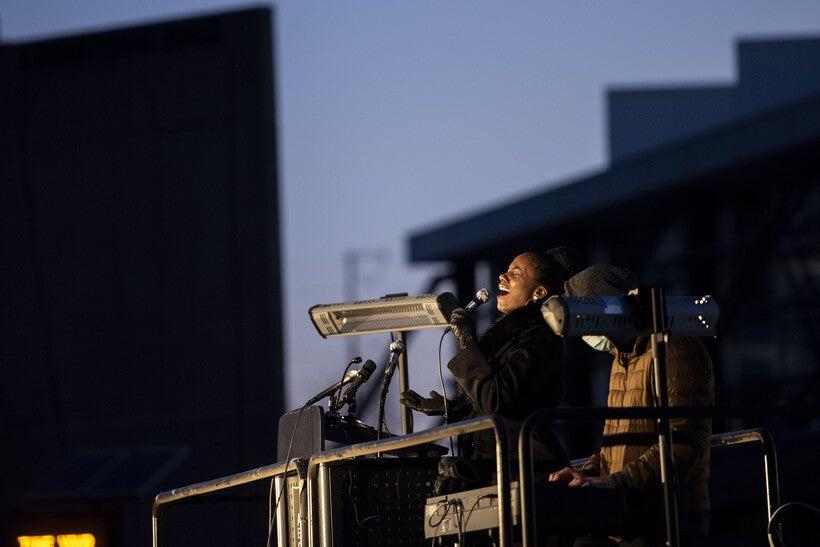 A singer tilts her head back as she belts a song.