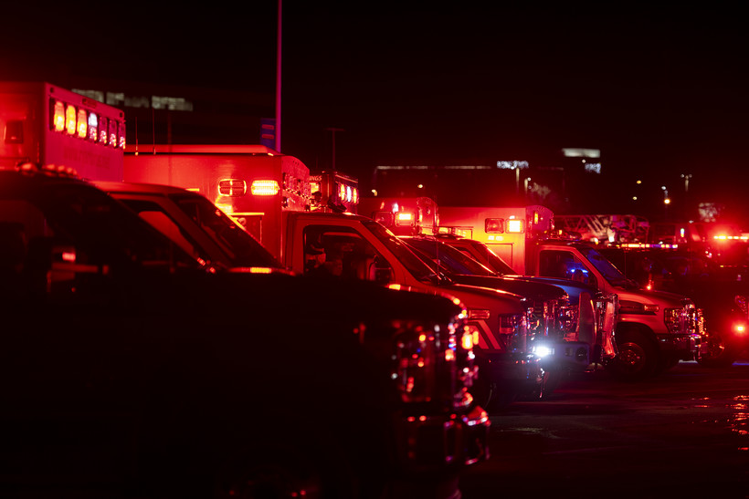 Ambulances glow with red light.