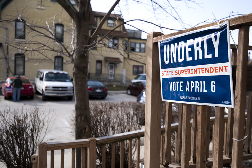 "A campaign sign says ""Underly, State Superintendent, Vote April 6"""