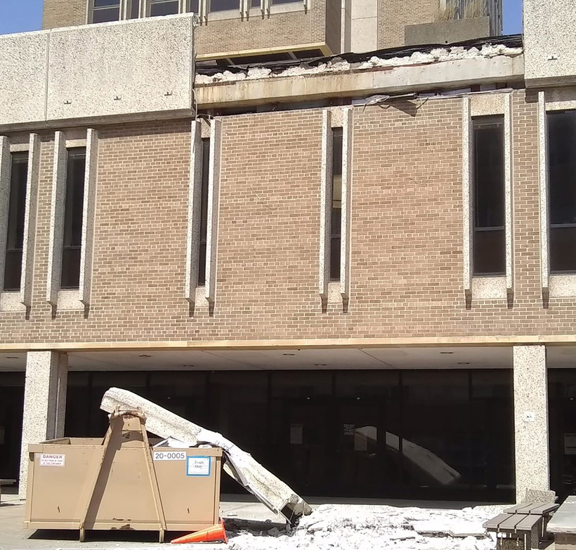 A concrete slab fell from Van Hise's third floor deck.