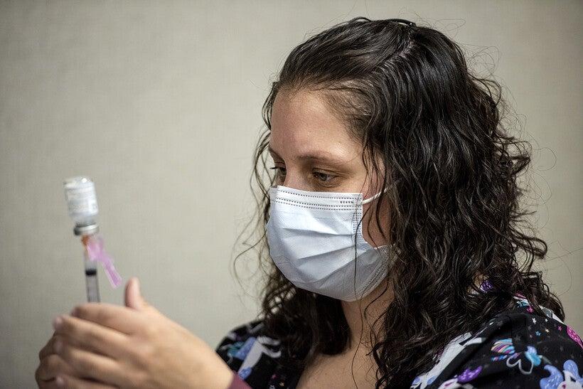 Wisconsin's Volunteer Vaccinators: It's 'A Joyful Occasion' To Help