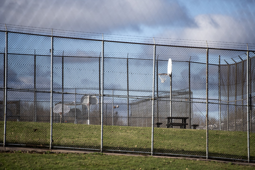 Fences surround outdoor areas.