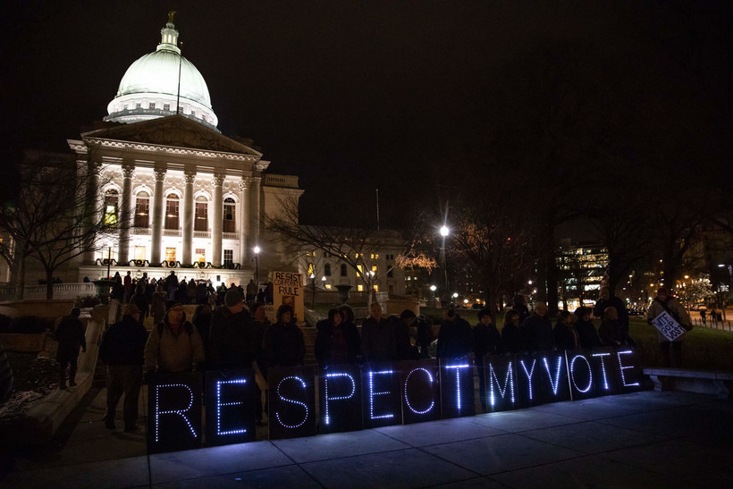Protesters gather on the Capitol steps to oppose lame-duck bills