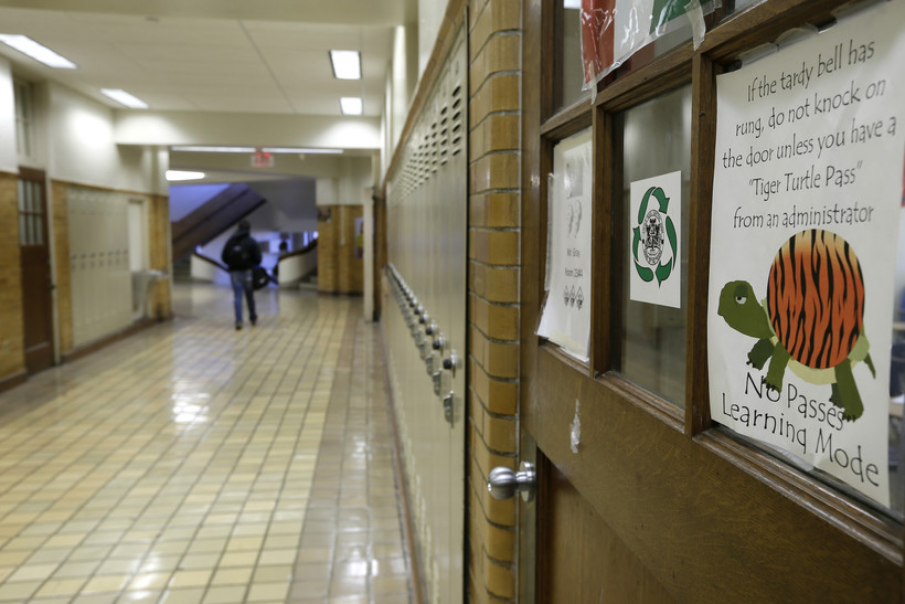 A student walks in a hallway at Little Rock Central High School