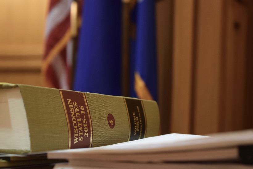 Law books and flag as seen on a judge's bench in a Dane County courtroom
