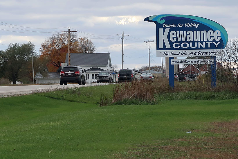 "A sign reads ""Thanks for visiting Kewaunee County."""