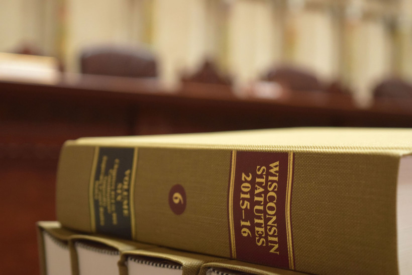 Law books in the hearing room of the Wisconsin Supreme Court