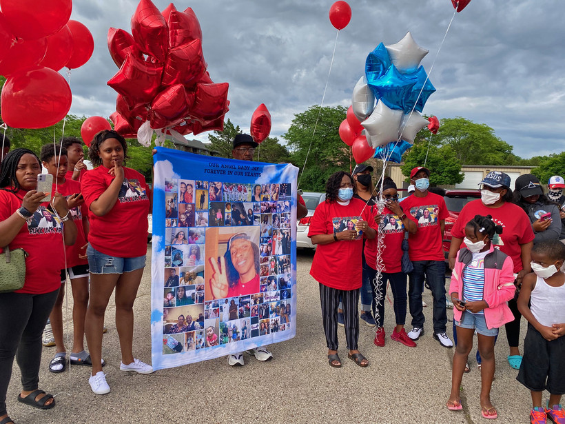 Community members gather at a balloon ceremony on the fourth anniversary of Jay Anderson Jr.'s death