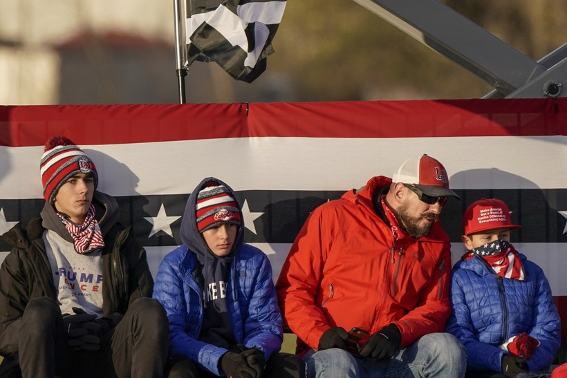 Supporters wait for President Donald Trump to speak at a campaign rally