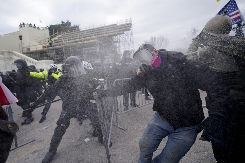 Trump supporters try to break through a police barrier, Wednesday, Jan. 6, 2021