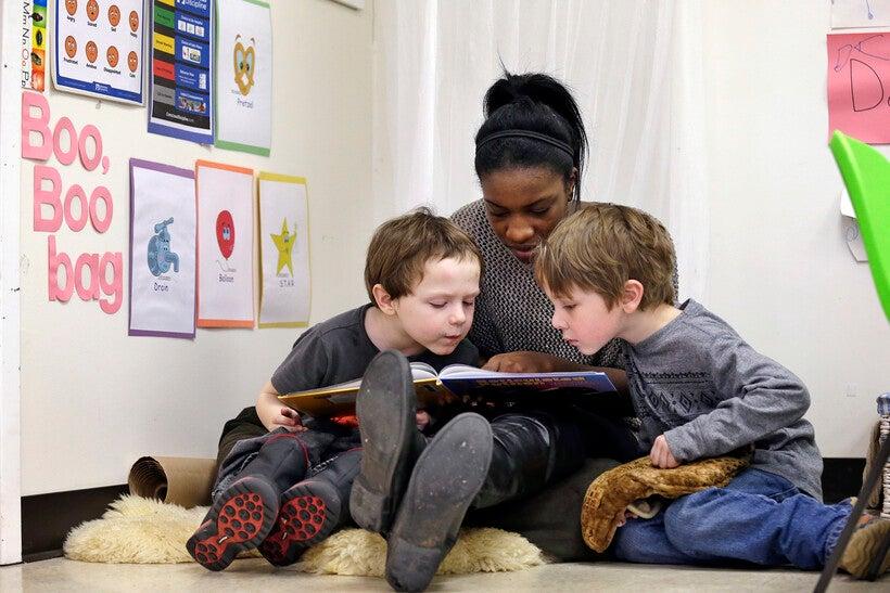 teacher reads to children