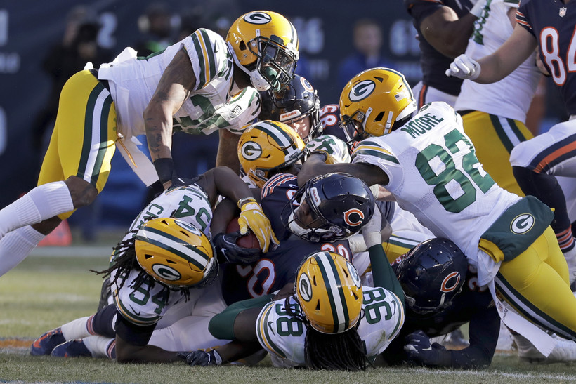 Chicago Bears' Benny Cunningham is tackled by Green Bay Packers