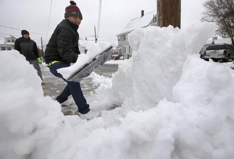Miguel Delao shovels snow in front of his home this winter